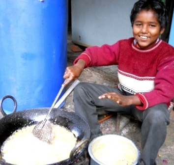 Happy Young Pakora Cook